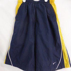 NIKE size 10-12, medium shorts.  Navy blue, yellow